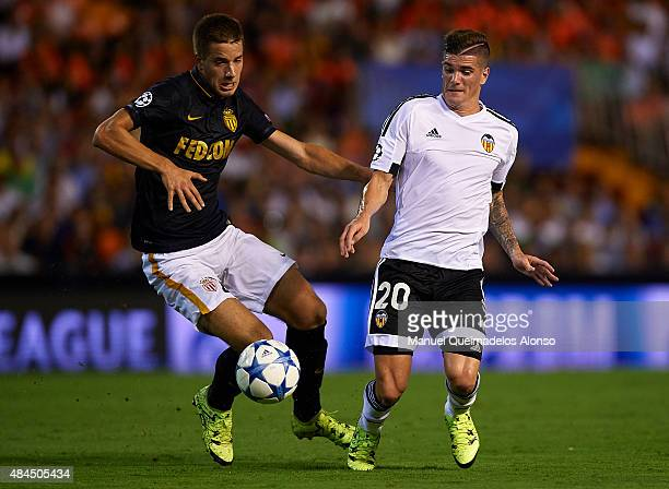 Rodrigo De Paul of Valencia battles for the ball with Mario Pasalic of Monaco during the UEFA Champions League Qualifying Round Play Off First Leg...