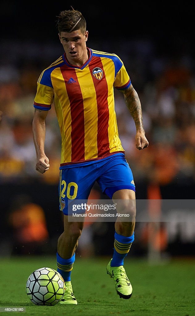 Rodrigo De Paul of Valencia runs with the ball during the pre-season friendly match between Valencia CF and AS Roma at Estadio Mestalla on August 8, 2015 in Valencia, Spain.