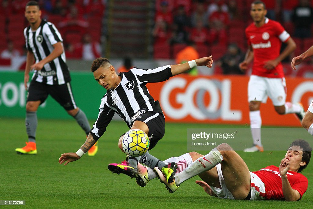 Rodrigo Dourado of Internacional battles for the ball against Neilton of Botafogo during the match between Internacional and Botafogo as part of...