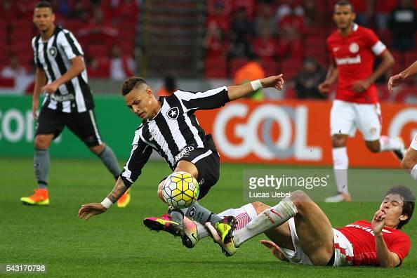 Rodrigo Dourado of Internacional battles for the ball against Neilton of Botafogo during the match between Internacional and Botafogo as part of...