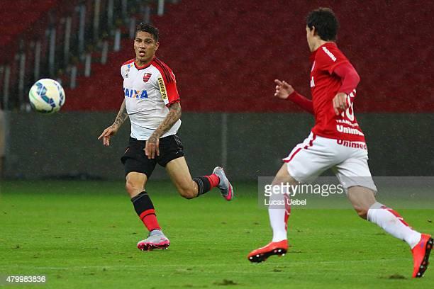 Rodrigo Dourado of Internacional battles for the ball against Paolo Guerrero of Flamengo during the match between Internacional and Flamengo as part...