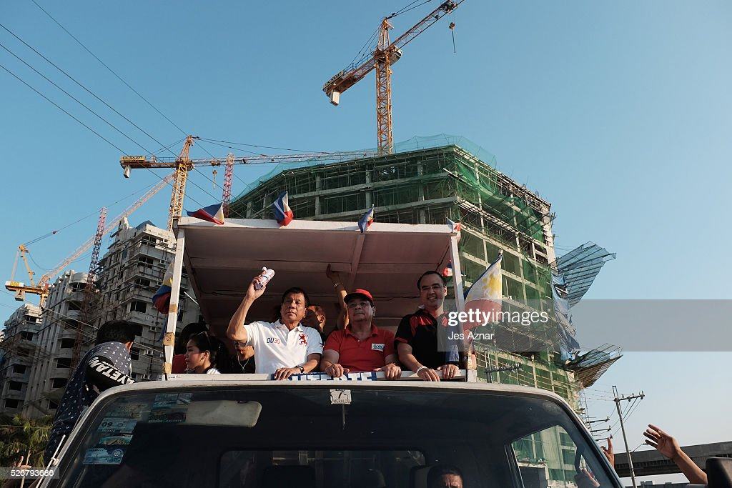Rodrigo Duterte and his supporters onboard a truck during a campaign motorcade on May 1, 2016 in Manila, Philippines. Presidential Candidate Rodrigo Duterte, a tough-talking mayor of Davao in Mindanao has been the surprise pre-election poll favourite, pulling away from his rivals despite controversial speeches and little national government experience. Opinion polls have shown Mr Duterte has maintained his lead with 33 percent support in the Philippines as Senator Grace Poe looks at an impossible odd, with only 22 percent supporting her. The Philippine presidential campaign ends on May 7 with elections on May 9 and features 5 presidential candidates vying for the top post.