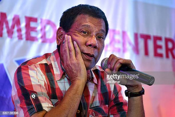 Rodrigo Duterte answers questions from journalists during a press conference on May 10 2016 in Davao City Philippines Duterte is set to become the...