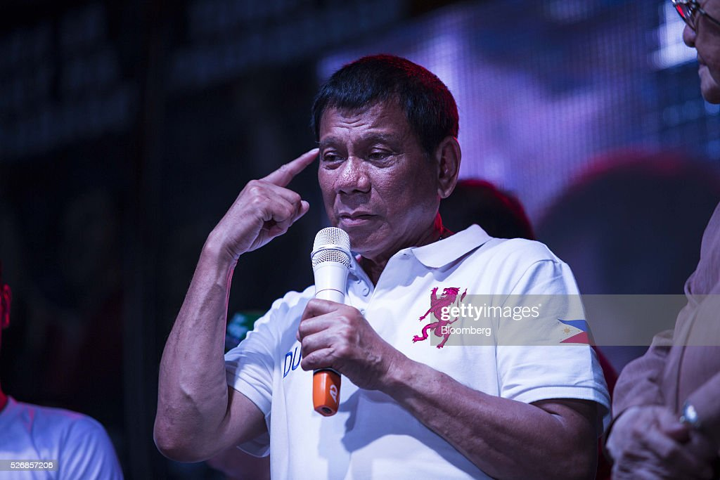 Rodrigo Duterte, mayor of Davao City and presidential candidate, gestures as he speaks during a campaign rally in Manila, the Philippines, on Sunday, May 1, 2016. Duterte, the crime-fighting mayor who is favored to win the Philippines May 9 presidential election, failed to declare tens of millions of dollars in assets, according to records released by a senator supporting rival candidate Grace Poe. Photographer: Taylor Weidman/Bloomberg via Getty Images
