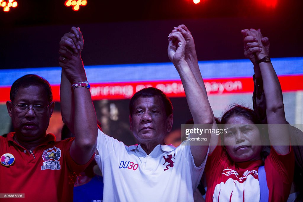 Rodrigo Duterte, mayor of Davao City and presidential candidate, center, cheers with the crowd during a campaign rally in Manila, the Philippines, on Sunday, May 1, 2016. Duterte, the crime-fighting mayor who is favored to win the Philippines May 9 presidential election, failed to declare tens of millions of dollars in assets, according to records released by a senator supporting rival candidate Grace Poe. Photographer: Taylor Weidman/Bloomberg via Getty Images