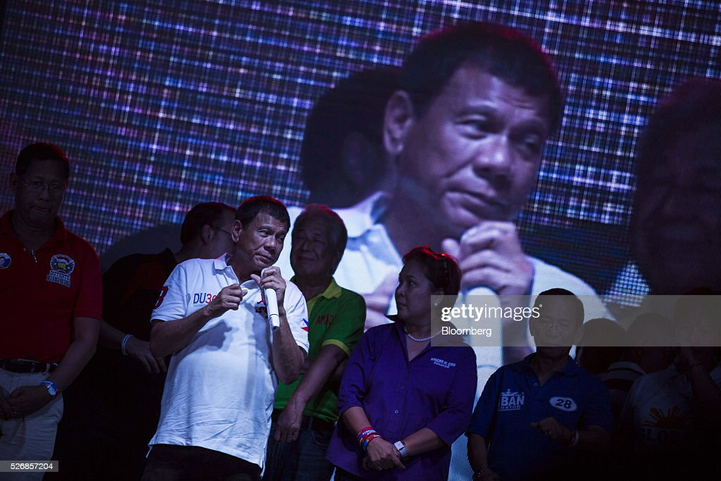 Rodrigo Duterte, mayor of Davao City and presidential candidate, pauses while speaking during a campaign rally in Manila, the Philippines, on Sunday, May 1, 2016. Duterte, the crime-fighting mayor who is favored to win the Philippines May 9 presidential election, failed to declare tens of millions of dollars in assets, according to records released by a senator supporting rival candidate Grace Poe. Photographer: Taylor Weidman/Bloomberg via Getty Images