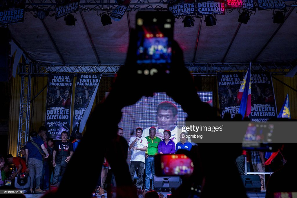 Rodrigo Duterte, mayor of Davao City and presidential candidate, speaks during a campaign rally in Manila, the Philippines, on Sunday, May 1, 2016. Duterte, the crime-fighting mayor who is favored to win the Philippines May 9 presidential election, failed to declare tens of millions of dollars in assets, according to records released by a senator supporting rival candidate Grace Poe. Photographer: Taylor Weidman/Bloomberg via Getty Images