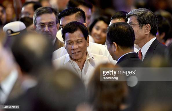 Rodrigo Duterte the Philippines' president center attends the Asian Development Bank 50th Anniversary reception in Manila the Philippines on Tuesday...