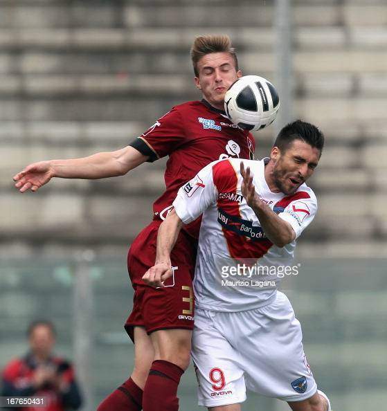 Rodrigo Ely of Reggina competes for the ball in air with Andrea Caracciolo of Brescia during the Serie B match between Reggina Calcio and Brescia...