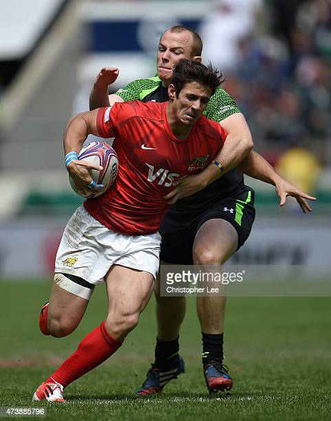Rodrigo Etchart of Argentina is tackled by Dan Fish of Wales during the Bowl Semi Final match between Argentina and Wales in the Marriott London...