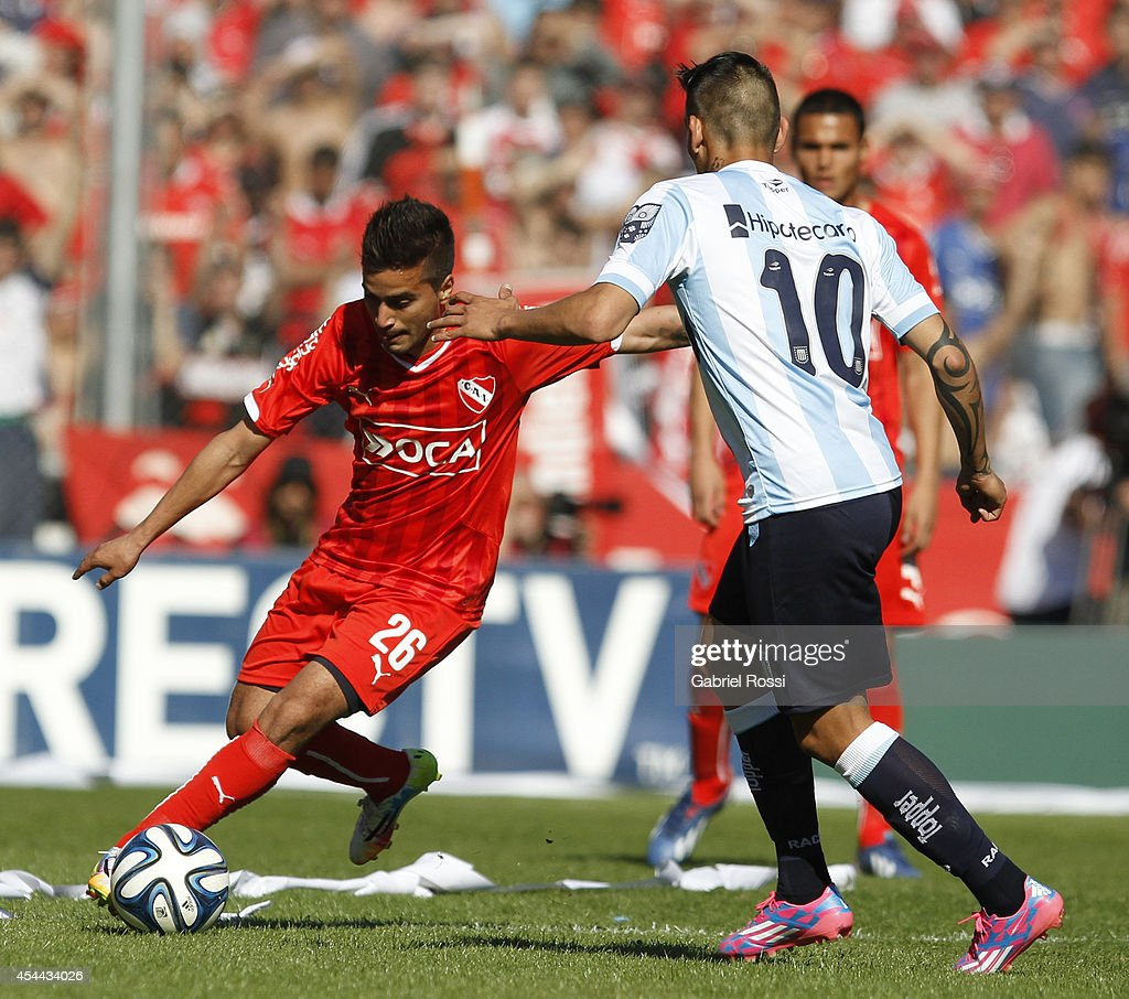 Rodrigo Gomez of Independiente fights for the ball with Ricardo Centurion of Racing Club during a match between Independiente and Racing as part of fifth round of Torneo de Transicion 2014 at Libertadores de America Stadium on August 31, 2014 in Buenos Aires, Argentina.