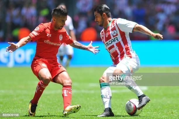 Rodrigo Gomez of Toluca marks Miguel Ponce of Necaxa during their Mexican Apertura football tournament match at the Nemesio Diez stadium in Toluca...