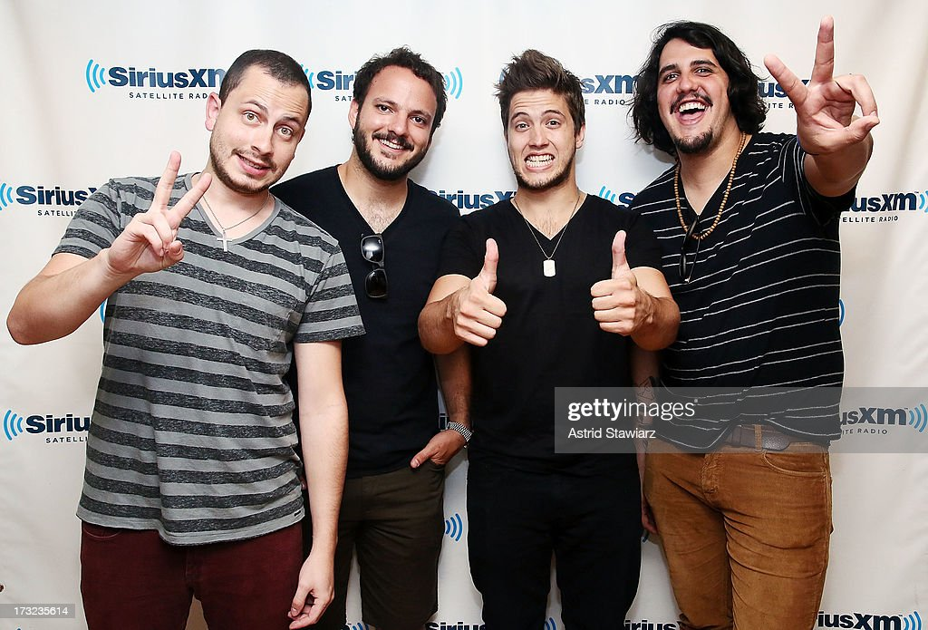 Rodrigo Gonsalves, Adrin Salas, Juan Victor Belisario and Orlando Martnez of Latin rock band VINILOVERSUS visit the SiriusXM Studios on July 10, 2013 in New York City.