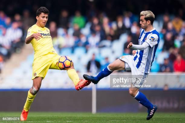 Rodrigo Hernandez of Villarreal CF duels for the ball with Juan Miguel Jimenez 'Juanmi' of Real Sociedad during the La Liga match between Real...