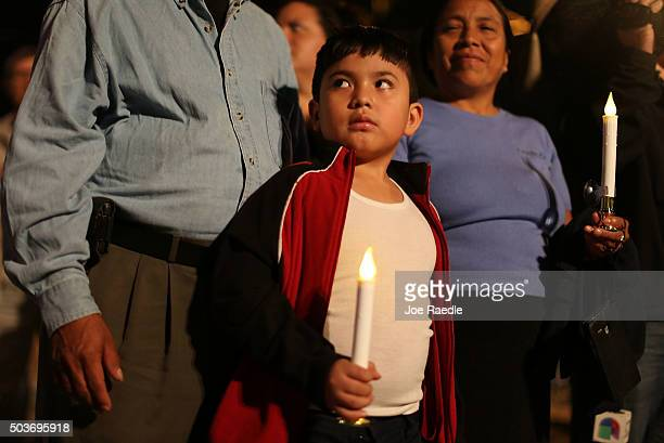 Rodrigo Hernandez whose family is originally from Guatemala attends a vigil with his family to protest against the deportation of undocumented...