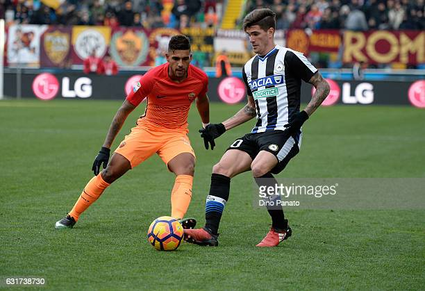Rodrigo Javier De Paul of Udinese Calcio competes with Emerson of AS Roma during the Serie A match between Udinese Calcio and AS Roma at Stadio...