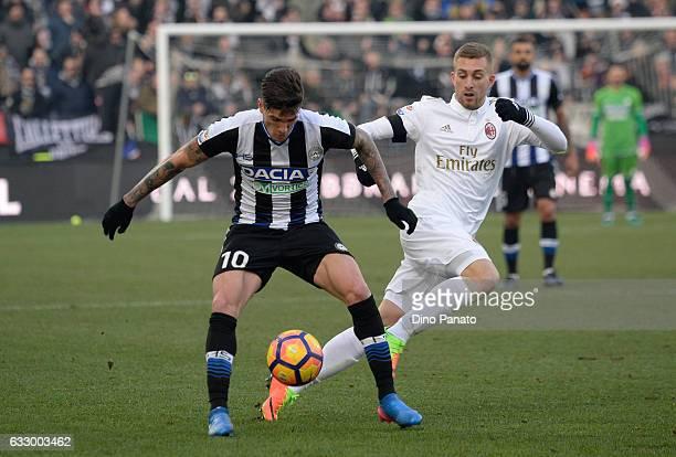 Rodrigo Javier De Paul of Udinese Calcio competes with Gerard Deulofeu of AC Milan during the Serie A match between Udinese Calcio and AC Milan at...