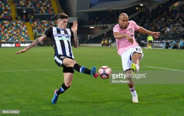 Rodrigo Javier De Paul of Udinese Calcio competes with Haitam Aleesami of US Citta di Palermo during the Serie A match between Udinese Calcio and US...