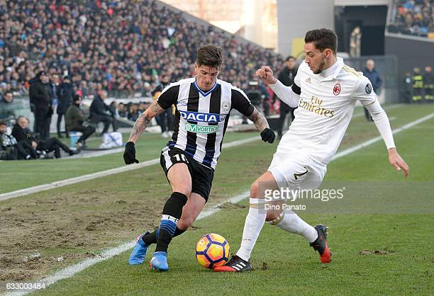 Rodrigo Javier De Paul of Udinese Calcio competes with Mattia De Sciglio of AC Milan during the Serie A match between Udinese Calcio and AC Milan at...