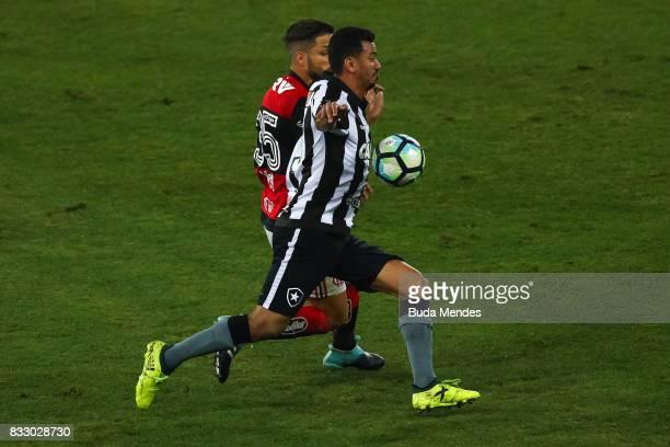 Rodrigo Lindoso of Botafogo struggles for the ball with Diego of Flamengo during a match between Botafogo and Flamengo as part of Copa do Brasil...