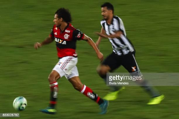Rodrigo Lindoso of Botafogo struggles for the ball with Willian Aro of Flamengo during a match between Botafogo and Flamengo as part of Copa do...