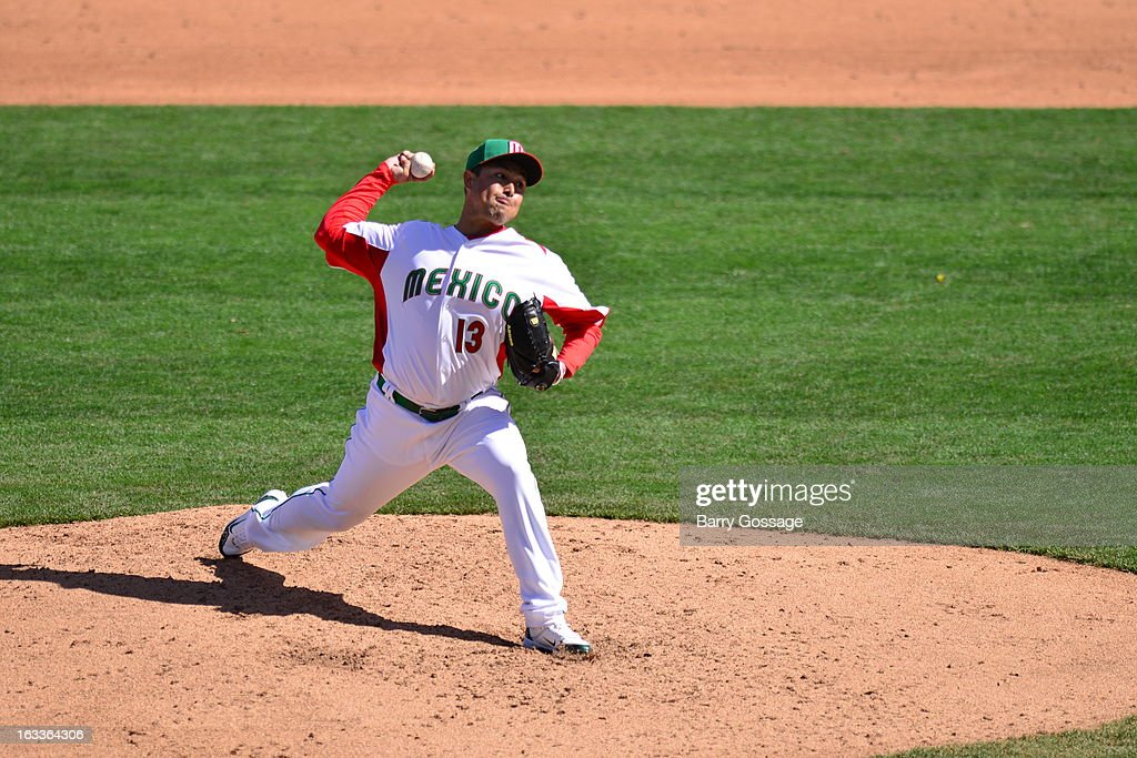 <a gi-track='captionPersonalityLinkClicked' href=/galleries/search?phrase=Rodrigo+Lopez&family=editorial&specificpeople=216384 ng-click='$event.stopPropagation()'>Rodrigo Lopez</a> #13 of Team Mexico pitches during Pool D, Game 1 between Italy and Mexico in the first round of the 2013 World Baseball Classic at Salt River Fields at Talking Stick on Thursday, March 7, 2013 in Phoenix, Arizona.