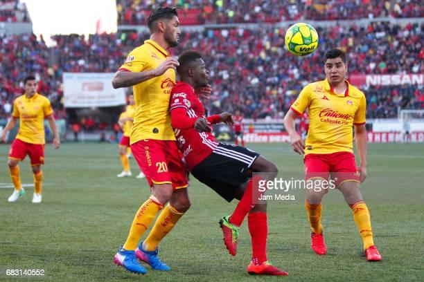 Rodrigo Millar of Morelia and Aviles Hurtado of Tijuana fight for the ball during the quarter finals second leg match between Tijuana and Morelia as...