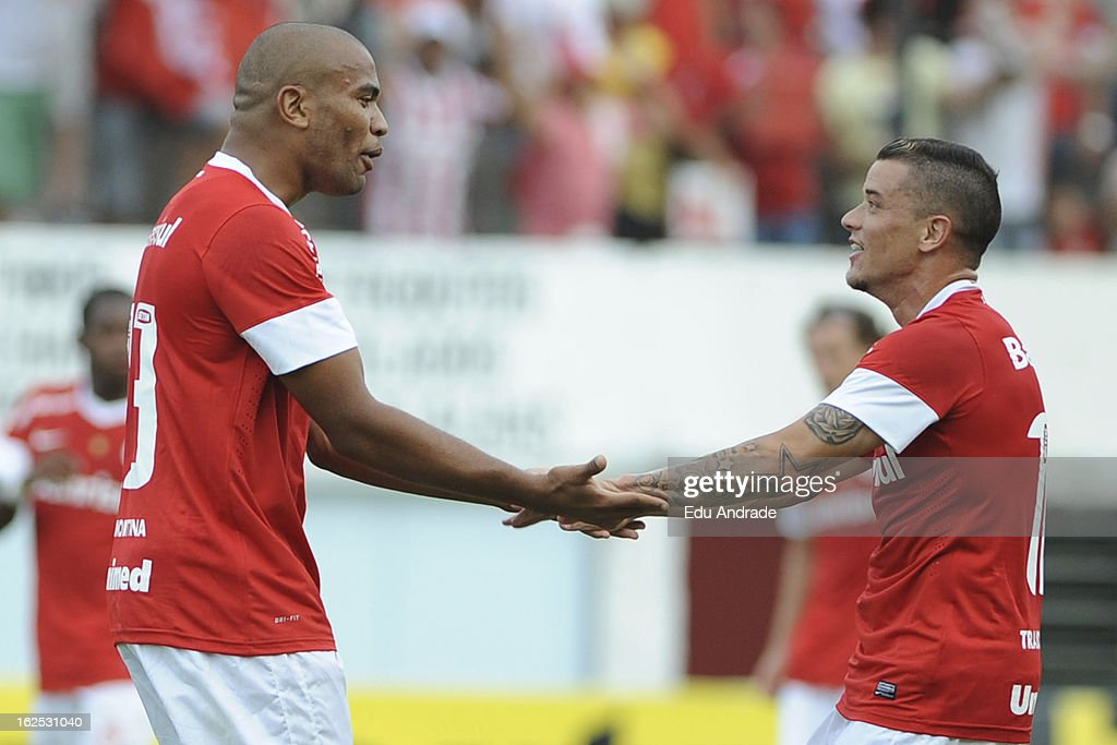 Rodrigo Moledo (L) and D'Alessandro of Internacional celebrates a goal during a match between Gremio and Internacional as part of the Gaucho championship at Centenario stadium on February 24, 2013 in Caixas Do Sul, Brazil.