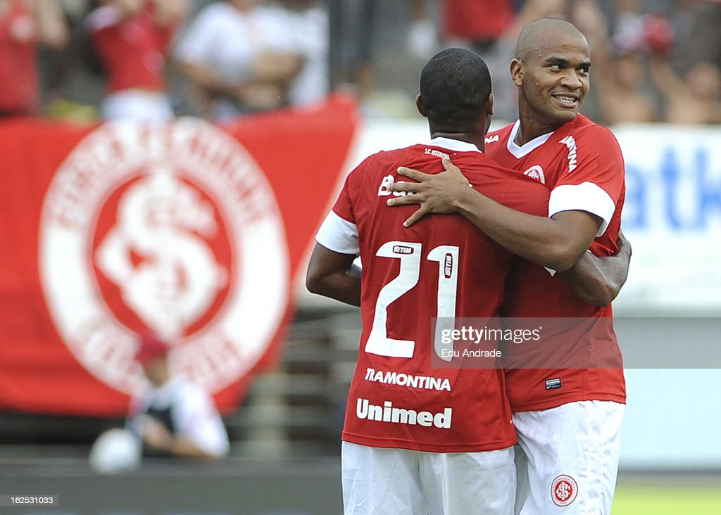 Rodrigo Moledo (R) of Internacional celebrates a goal during a match between Gremio and Internacional as part of the Gaucho championship at Centenario stadium on February 24, 2013 in Caixas Do Sul, Brazil.