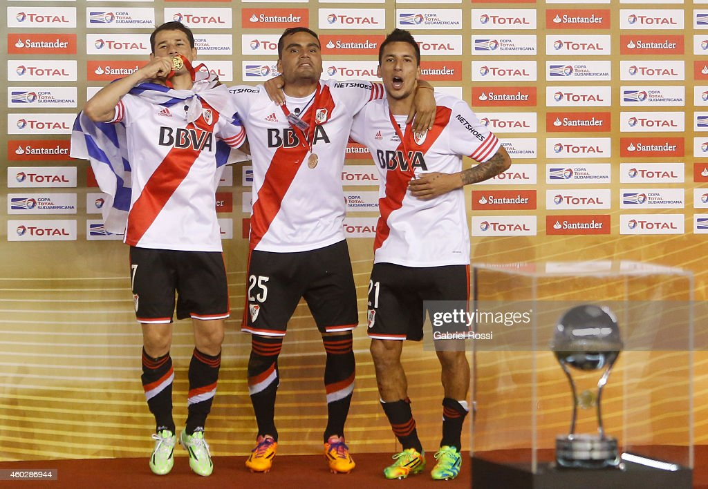 Rodrigo Mora, Gabriel Mercado and Leonel Vangioni of River Plate celebrate after winning the second leg final match between River Plate and Atletico Nacional as part of Copa Total Sudamericana 2014 at Antonio Vespucio Liberti Stadium on December 10, 2014 in Buenos Aires, Argetina.