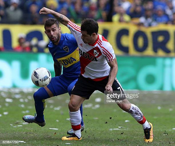 Rodrigo Mora of River Plate and Gino Peruzzi of Boca Juniors battle for the ball during a match between Boca Juniors and River Plate as part of...