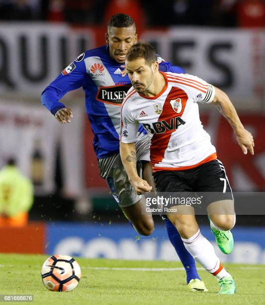 Rodrigo Mora of River Plate and Jordan Andres Jaime of Emelec compete for the ball during a group stage match between River Plate and Emelec as part...