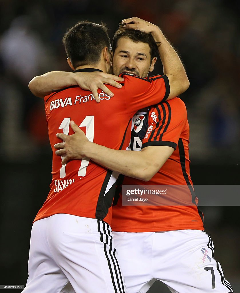 Rodrigo Mora of River Plate celebrates with his teammate <a gi-track='captionPersonalityLinkClicked' href=/galleries/search?phrase=Javier+Saviola&family=editorial&specificpeople=207198 ng-click='$event.stopPropagation()'>Javier Saviola</a> after scoring the tying goal during a match between River Plate and Aldosivi as part of round 28 of Torneo de Primera Division at Monumental Antonio Vespucio Liberti Stadium on October 18, 2015 in Buenos Aires, Argentina.