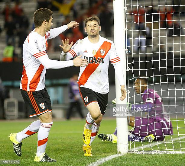 Rodrigo Mora of River Plate celebrates with his teammate Lucas Alario after scoring the second goal of his team during a first leg match between...