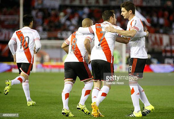 Rodrigo Mora of River Plate celebrates with his teammates after scoring the first goal of his team during a match between River Plate and Lanus as...