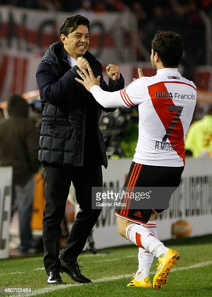 Rodrigo Mora of River Plate celebrates with Marcelo Gallardo coach of River Plate after scoring the second goal of his team during a first leg Semi...