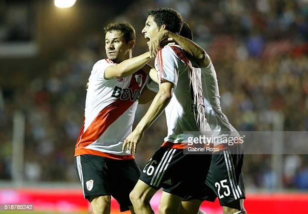 Rodrigo Mora of River Plate celebrates with teammates Ignacio Fernandez and Gabriel Mercado after scoring the first goal of his team during a match...
