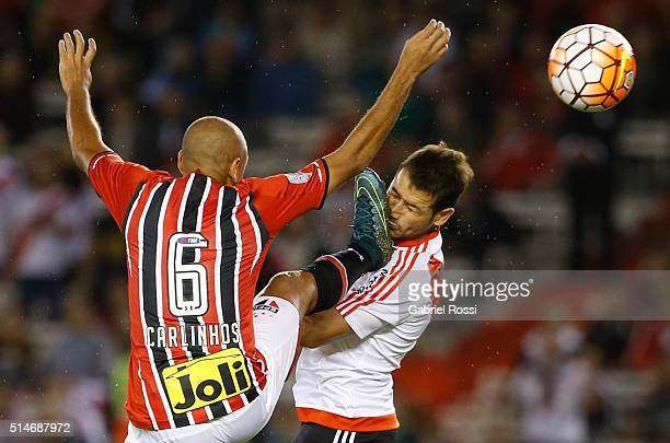 Rodrigo Mora of River Plate fights for the ball with Carlinhos of Sao Paulo during a match between River Plate and Sao Paulo as part of Group 1 of...