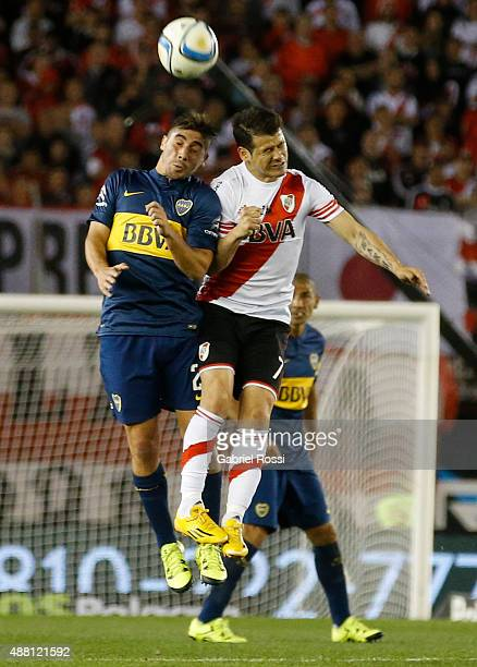 Rodrigo Mora of River Plate fights for the ball with Cristian Erbes of Boca Juniors during a match between River Plate and Boca Juniors as part of...
