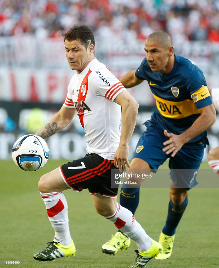 Rodrigo Mora of River Plate fights for the ball with Daniel Diaz of Boca Juniors during a match between River Plate and Boca Juniors as part of 24th round of Torneo Primera Division 2015 at Monumental Antonio Vespucio Liberti Stadium on September 13, 2015 in Buenos Aires, Argentina.