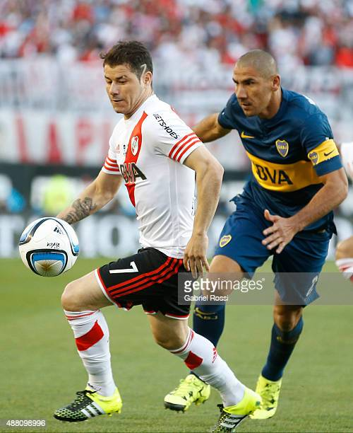 Rodrigo Mora of River Plate fights for the ball with Daniel Diaz of Boca Juniors during a match between River Plate and Boca Juniors as part of 24th...