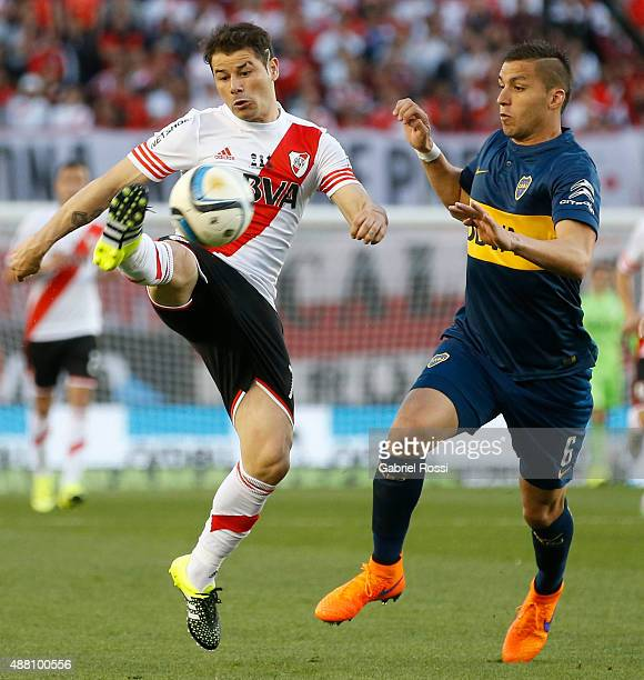 Rodrigo Mora of River Plate fights for the ball with Fernando Tobio of Boca Juniors during a match between River Plate and Boca Juniors as part of...