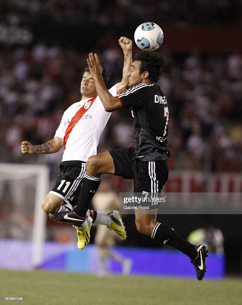 Rodrigo Mora of River Plate fights for the ball with Gelabert of Estudiantes during the match between River Plate and Estudiantes of Torneo Final 2013 on February 17, 2013 in Buenos Aires, Argentina.