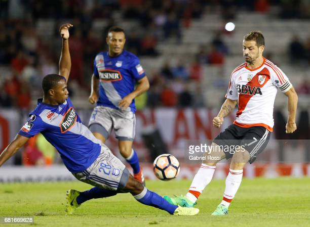 Rodrigo Mora of River Plate fights for the ball with Jordan Andres Jaime of Emelec during a group stage match between River Plate and Emelec as part...
