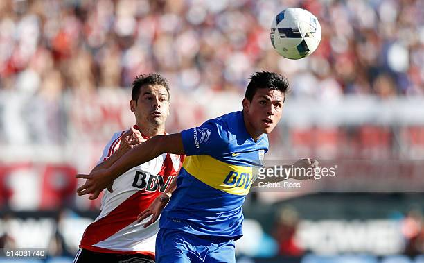 Rodrigo Mora of River Plate fights to head the ball with Jonathan Silva of Boca Juniors during a match between River Plate and Boca Juniors as part...