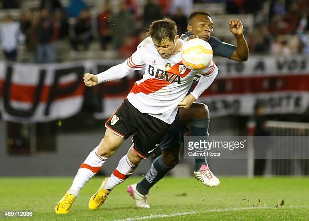 Rodrigo Mora of River Plate heads the ball to score during a first leg match between River Plate and Liga Deportiva Universitaria de Quito as part of...