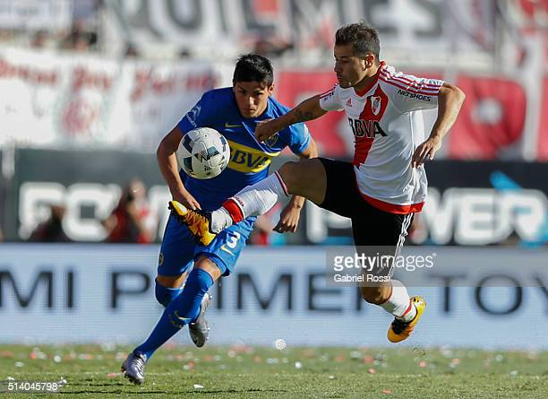 Rodrigo Mora of River Plate struggles for the ball with Jonathan Silva of Boca Juniors during a match between River Plate and Boca Juniors as part of...