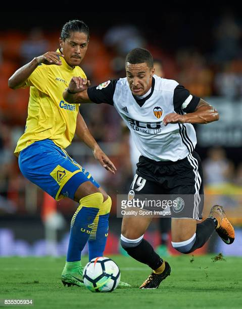Rodrigo Moreno of Valencia competes for the ball with Mauricio Lemos of Las Palmas during the La Liga match between Valencia and Las Palmas at...