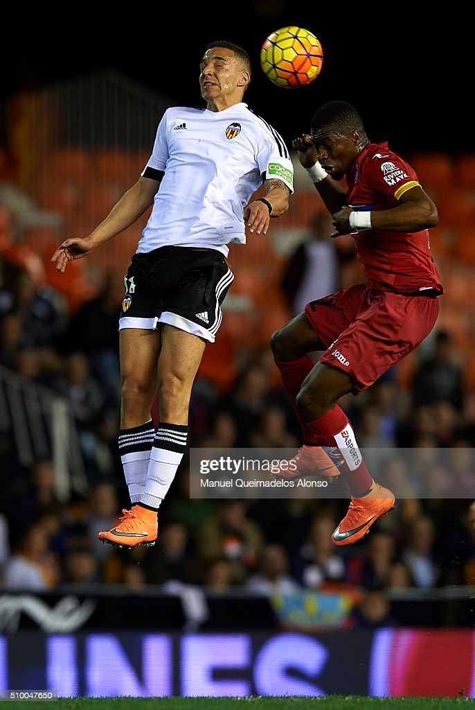 Rodrigo Moreno (L) of Valencia competes for the ball with Papakouly Diop of Espanyol during the La Liga match between Valencia CF and RCD Espanyol at Estadi de Mestalla on February 13, 2016 in Valencia, Spain.