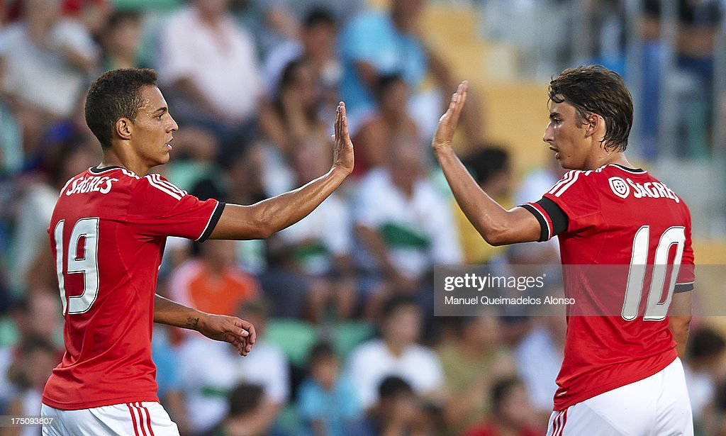 Rodrigo (L) of Benfica celebrates with his teammate Djuricic during a friendly match between Elche CF and Benfica at Estadio Martinez Valero on July 31, 2013 in Elche, Spain.
